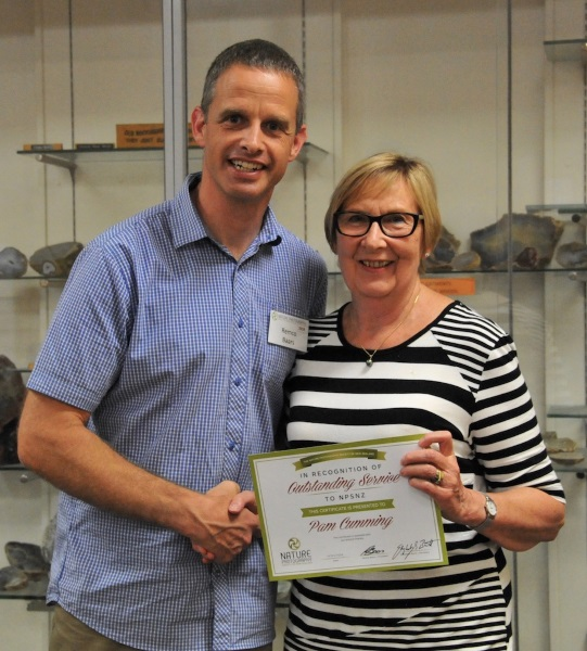 Remco presents Pam with Service Award
